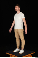 Trent brown trousers casual dressed standing white sneakers white t shirt whole body 0002.jpg